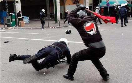 Antifa beating police